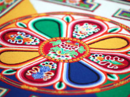 sand mandala design of Chenrezig, the Buddha of Compassion
