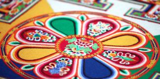 sand mandala design of Chenrezig, the Buddha of Compassion