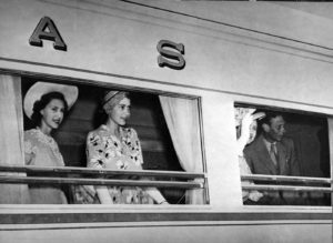 The Royal Family wave to crowds from the White Train - seen in The Last Hurrah by Graham Viney