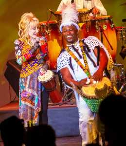 Dolly Parton and Patrick Pobee in Drumstruck at Dollywood. Picture: Curtis Bilbun