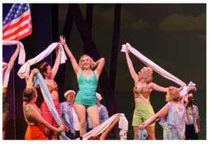 Andrea Fourie as Nellie Forbush with the cast of South Pacific. Picture: Mandy Freeman